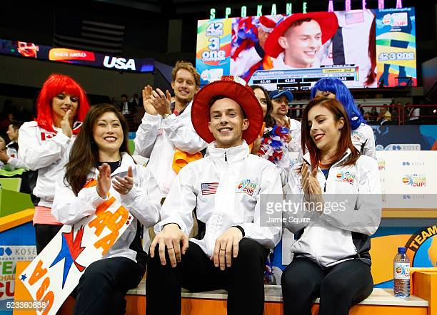 Adam Rippon of Team North America celebrates with team captain Kristi Yamaguchi and teammates after seeing his score following the Men's Singles...