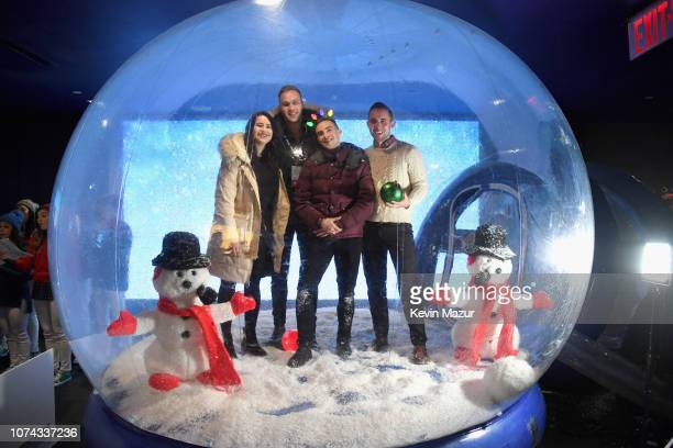 Adam Rippon poses inside a snowglobe during Full Frontal With Samantha Bee Presents Christmas On ICE at PlayStation Theater on December 17 2018 in...