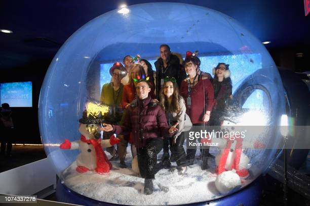 Adam Rippon poses inside a snowglobe during Full Frontal With Samantha Bee Presents Christmas On I.C.E. At PlayStation Theater on December 17, 2018...