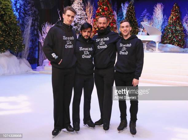 Adam Rippon poses with the Abolish ICE Skaters in the The Full Frontal x Opening Ceremony collaboration collection hoodie during Full Frontal With...