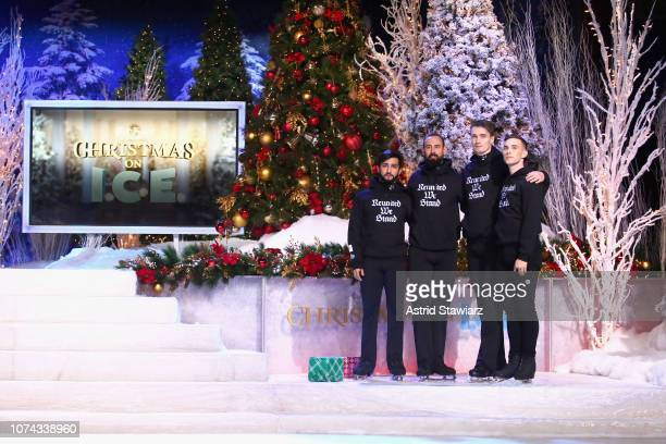 Adam Rippon poses with the Abolish I.C.E. Skaters in the The Full Frontal x Opening Ceremony collaboration collection hoodie during Full Frontal With...