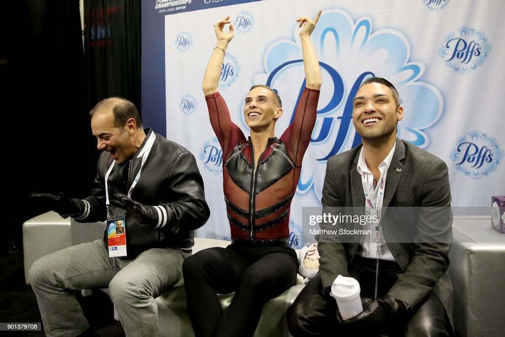 Adam Rippon reacts to his score in the kiss and cry with his coaches Rafael Arutunian and Derrick Delmore after skating in the Men's Short Program during the 2018 Prudential U.S. Figure Skating Championships at the SAP Center on January 4, 2018 in San Jose, California.