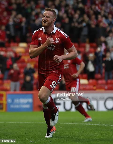 Adam Rooney of Aberdeen celebrates after he scores a penalty during the UEFA Europa League First Qualifying Round First Leg match between Aberdeen...