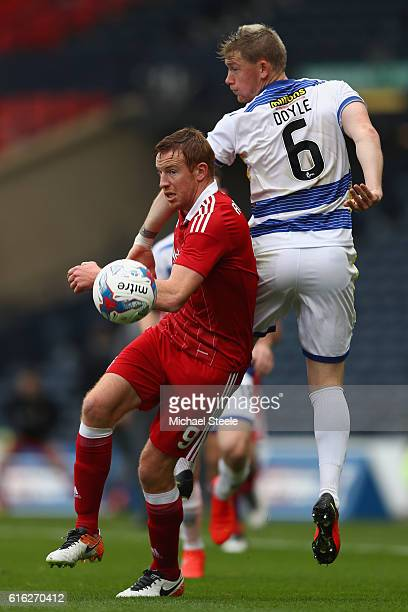 Adam Rooney of Aberdeen clashes with Michael Doyle of Greenock during the Betfred Cup SemiFinal match between Greenock Morton and Aberdeen at Hampden...