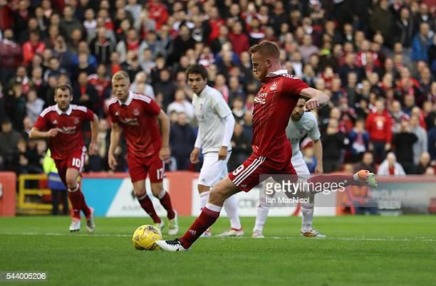 Adam Rooney of Aberdeen scores a penalty during the UEFA Europa League First Qualifying Round First Leg match between Aberdeen and CS Fola Esch at...