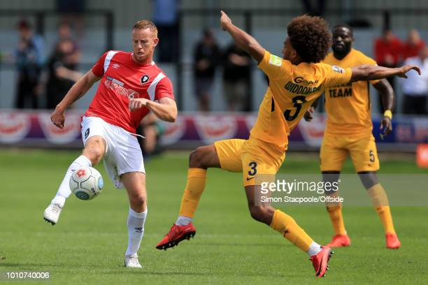 Adam Rooney of Salford battles with Joe Widdowson of Orient during the Vanarama National League match between Salford City and Leyton Orient at Moor...