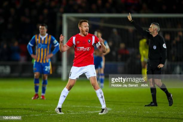 Adam Rooney of Salford City celebrates after scoring a goal to make it 12 during the Emirates FA Cup First Round Replay match between Salford City...