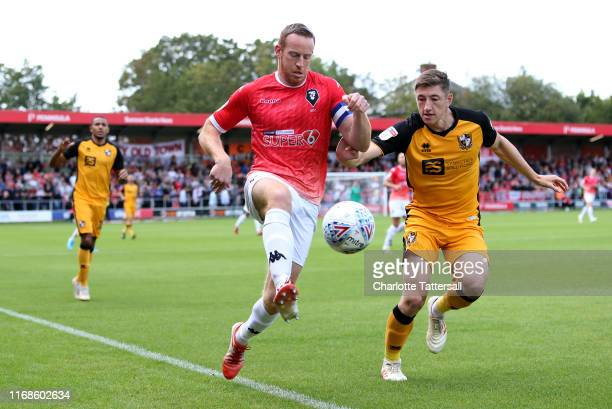 Adam Rooney of Salford jumps to control the ball under pressure from Adam Crookes of Port Vale during the Sky Bet League Two match between Salford...