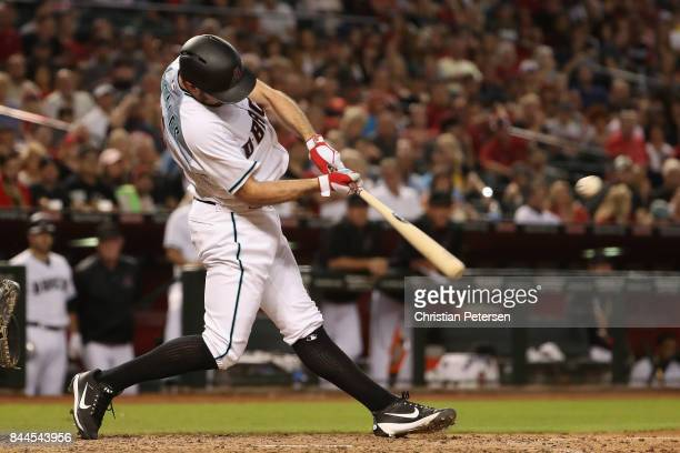 Adam Rosales of the Arizona Diamondbacks hits a single against the San Diego Padres during the sixth inning of the MLB game at Chase Field on...