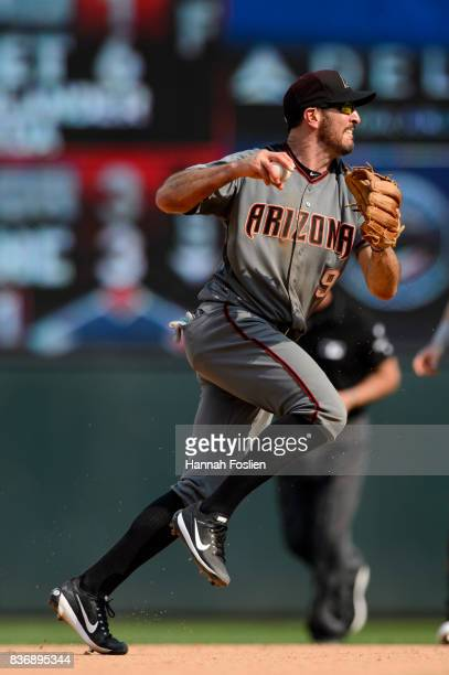 Adam Rosales of the Arizona Diamondbacks makes a play at shortstop against the Minnesota Twins during the game on August 20 2017 at Target Field in...