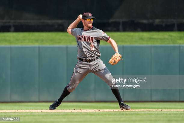 Adam Rosales of the Arizona Diamondbacks throws against the Minnesota Twins on August 20 2017 at Target Field in Minneapolis Minnesota The Twins...
