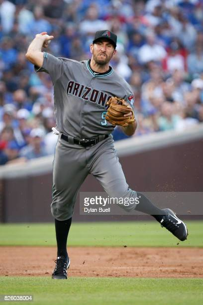 Adam Rosales of the Arizona Diamondbacks throws to first base in the first inning against the Chicago Cubs at Wrigley Field on August 1 2017 in...