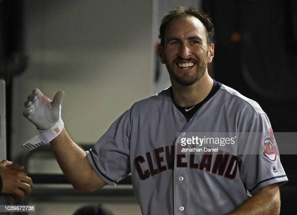 Adam Rosales of the Cleveland Indians smiles in the dugout after hitting a solo home run in the 9th inning against the Chicago White Sox at...