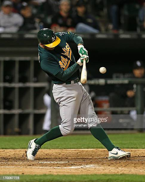Adam Rosales of the Oakland Athletics hits the gamewinning home run a solo shot in the 10th inning against the Chicago White Sox at US Cellular Field...