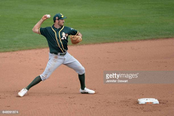 Adam Rosales of the Oakland Athletics makes the out at first in the fourth inning of the spring training game against the Seattle Mariners at Peoria...