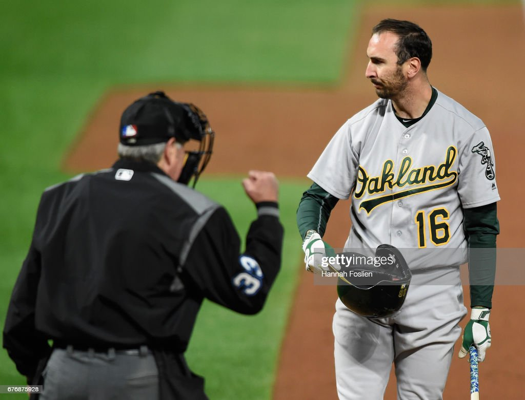 Adam Rosales #16 of the Oakland Athletics reacts as home plate umpire Mike Winters #33 calls him out on strikes during the seventh inning of the game on May 2, 2017 at Target Field in Minneapolis, Minnesota. The Twins defeated the Athletics 9-1.
