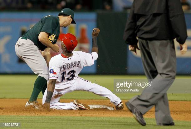 Adam Rosales of the Oakland Athletics tags out Jurickson Profar of the Texas Rangers on an attempted steal during the sixth inning of a baseball game...