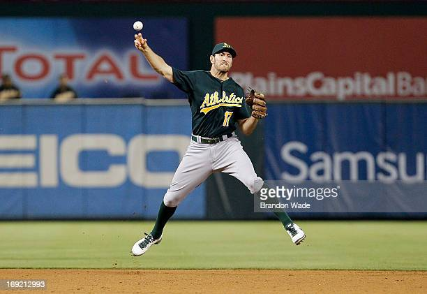 Adam Rosales of the Oakland Athletics throws to first to force out Craig Gentry of the Texas Rangers during the fifth inning of a baseball game at...