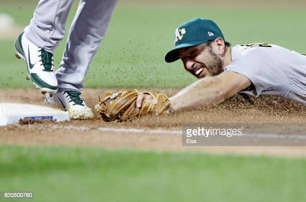 Adam Rosales of the Oakland Athletics tries to make it to first base before Lucas Duda of the New York Mets in the sixth inning on July 21 2017 at...