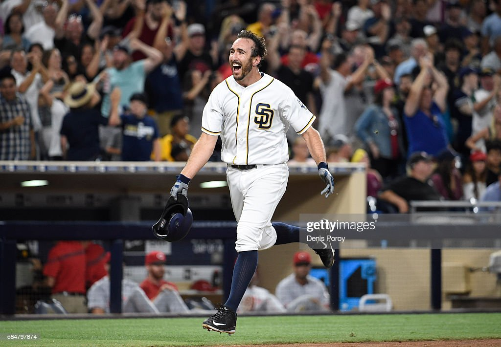 Adam Rosales #9 of the San Diego Padres celebrates after hitting a walk-off solo home run during the tenth inning of a baseball game against the Cincinnati Reds at PETCO Park on July 30, 2016 in San Diego, California. The Padres won 2-1.
