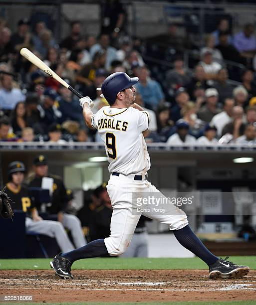 Adam Rosales of the San Diego Padres hits a solo home run during the fifth inning of a baseball game against the Pittsburgh Pirates at PETCO Park on...