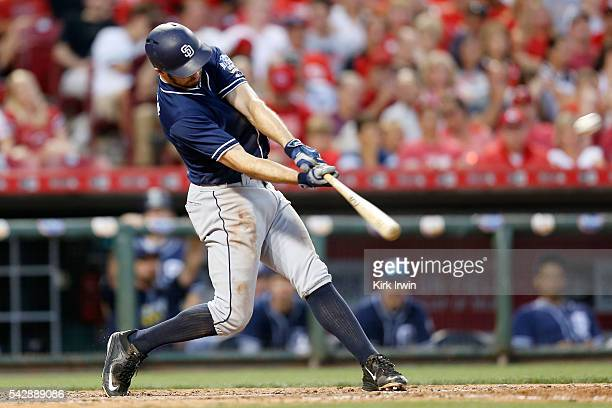 Adam Rosales of the San Diego Padres hits a solo home run during the sixth inning of the game against the Cincinnati Reds at Great American Ball Park...