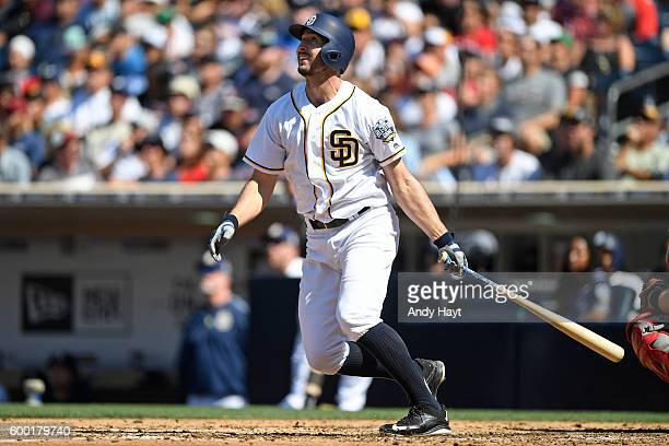 Adam Rosales of the San Diego Padres hits a two run home run during the game against the Boston Red Sox at PETCO Park on September 5 2016 in San...