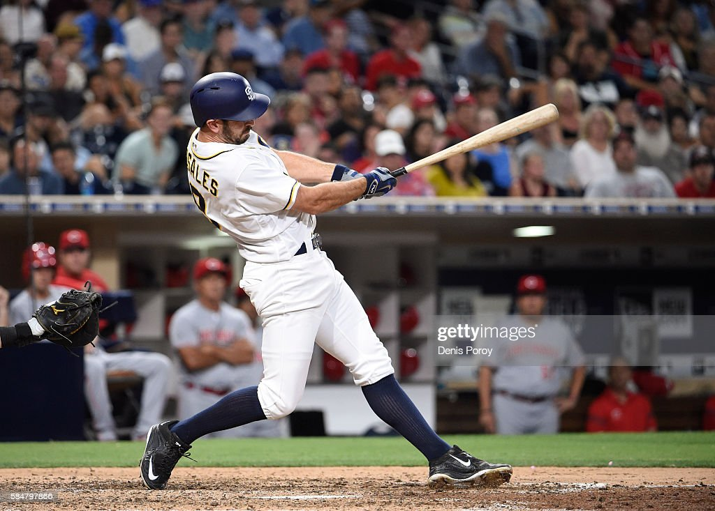 Adam Rosales #9 of the San Diego Padres hits a walk-off solo home run during the tenth inning of a baseball game against the Cincinnati Reds at PETCO Park on July 30, 2016 in San Diego, California. The Padres won 2-1.