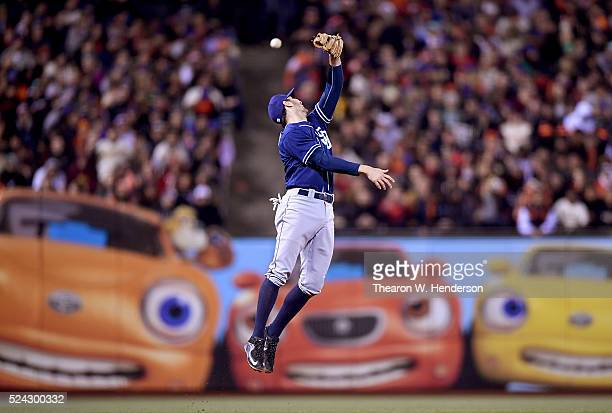 Adam Rosales of the San Diego Padres leaps for this ball that goes over his glove for an rbi double off the bat of Angel Pagan of the San Francisco...