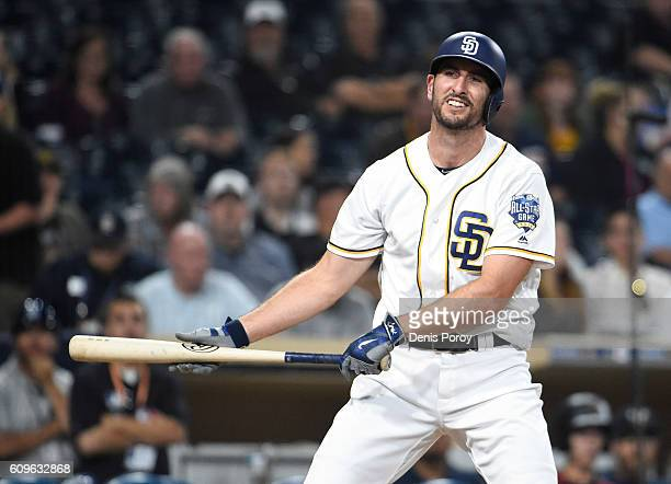 Adam Rosales of the San Diego Padres reacts after striking out for the final out in the ninth inning of a baseball game against the Arizona...