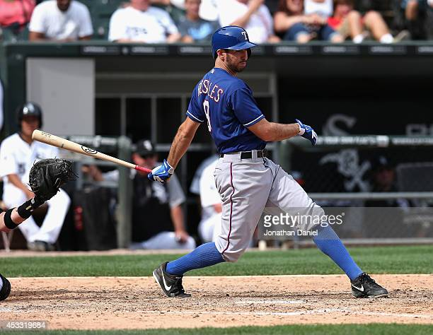 Adam Rosales of the Texas Rangers bats against the Chicago White Sox at US Cellular Field on August 6 2014 in Chicago Illinois The Rangers defeated...