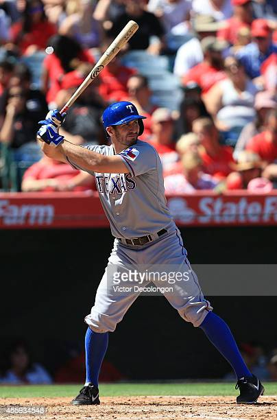 Adam Rosales of the Texas Rangers bats in the fourth inning during the MLB game against the Los Angeles Angels of Anaheim at Angel Stadium of Anaheim...