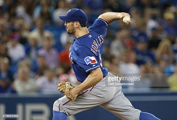 Adam Rosales of the Texas Rangers delivers a pitch in the eighth inning during MLB game action against the Toronto Blue Jays on June 26 2015 at...