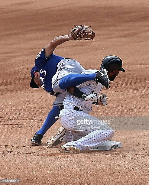 Adam Rosales of the Texas Rangers falls over Alexei Ramirez of the Chicago White Sox in the 5th inning after turnin a double play at US Cellular...