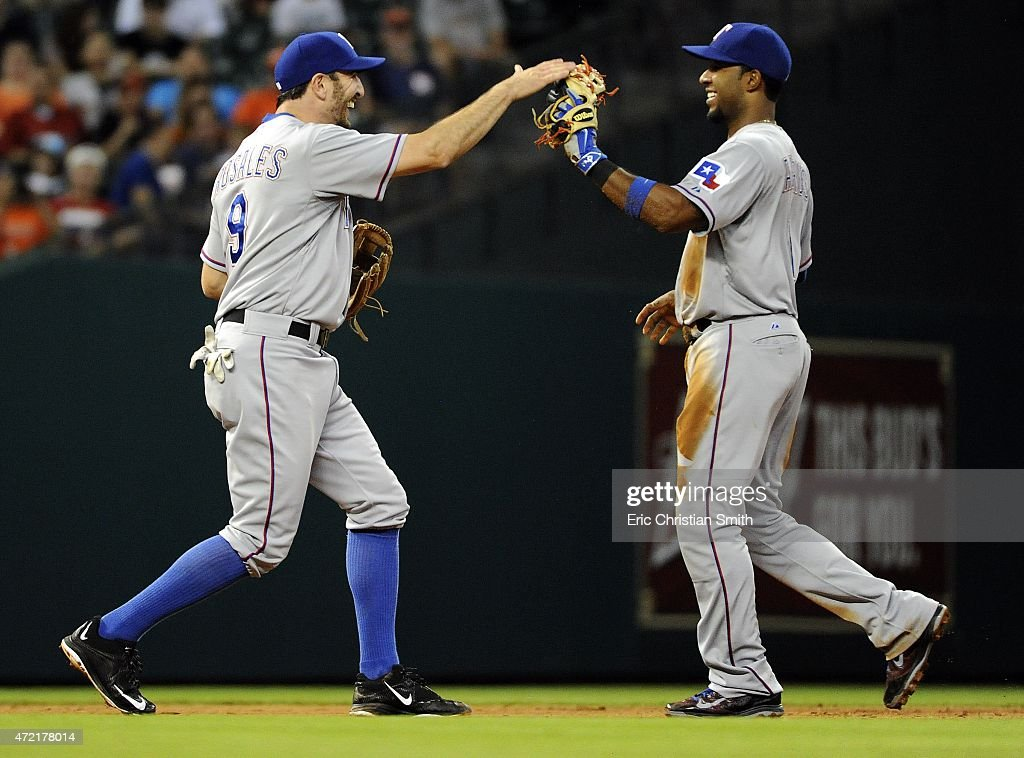 Adam Rosales #9 of the Texas Rangers, left, and Elvis Andrus #1 celebrate their double play during the fifth inning against the Houston Astros at Minute Maid Park on May 4, 2015 in Houston, Texas.