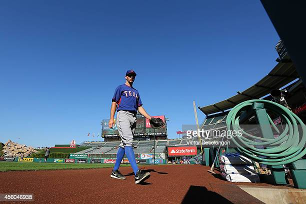 Adam Rosales of the Texas Rangers walks toward the dugout during warmup prior to their MLB game against the Los Angeles Angels of Anaheim at Angel...