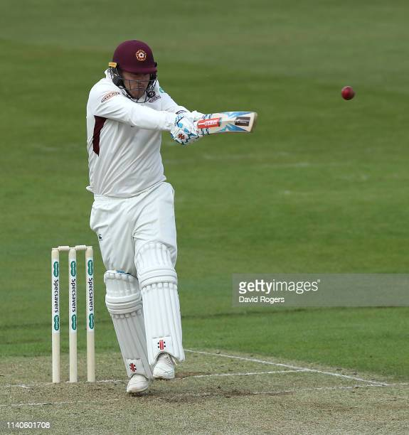 Adam Rossington of Northamptonshire pulls the ball during the Specsavers County Championship Division Two match between Northamptonshire and...