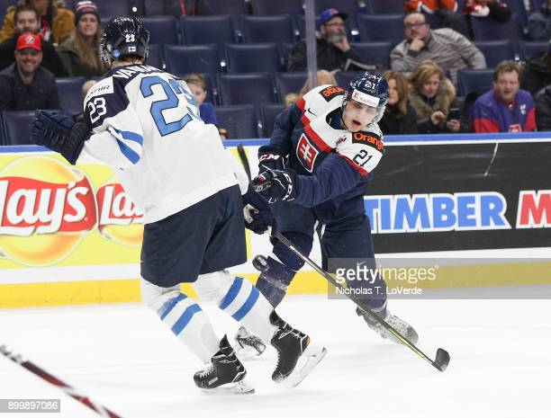 Adam Ruzicka of Slovakia shoots the puck past Urho Vaakanainen of Finland during the first period of play in the IIHF World Junior Championships at...