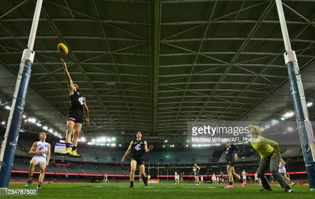 Adam Saad of the Blues attempts to touch the ball on the line during the 2021 AFL Round 23 match between the Carlton Blues and the GWS Giants at...