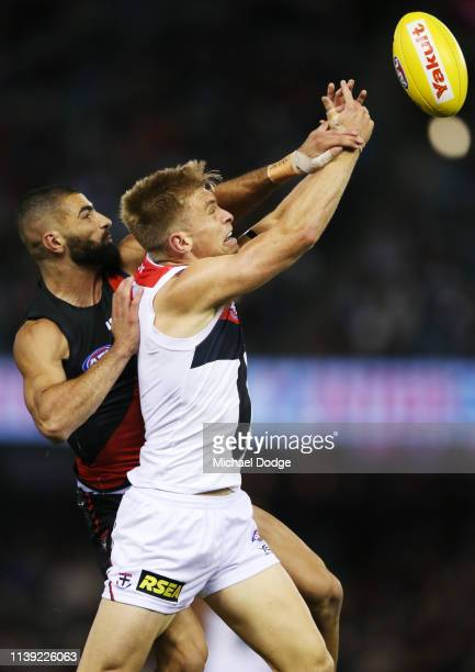 Adam Saad of the Bombers competes for the ball against Sebastian Ross of the Saints during the round two AFL match between the Essendon Bombers and...