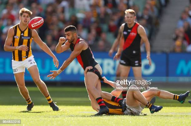 Adam Saad of the Bombers is tackled during the 2018 AFL round seven match between the Essendon Bombers and the Hawthorn Hawks at the Melbourne...