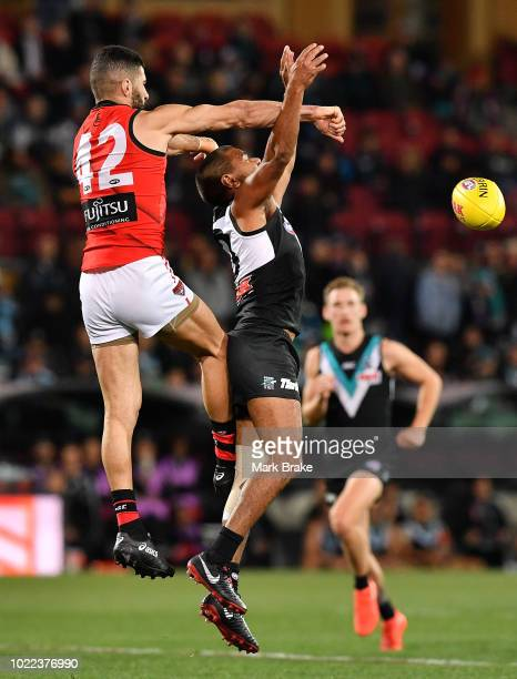 Adam Saad of the Bombers spoils Jake Neade of Port Adelaide during the round 23 AFL match between Port Adelaide Power and the Essendon Bombers at...