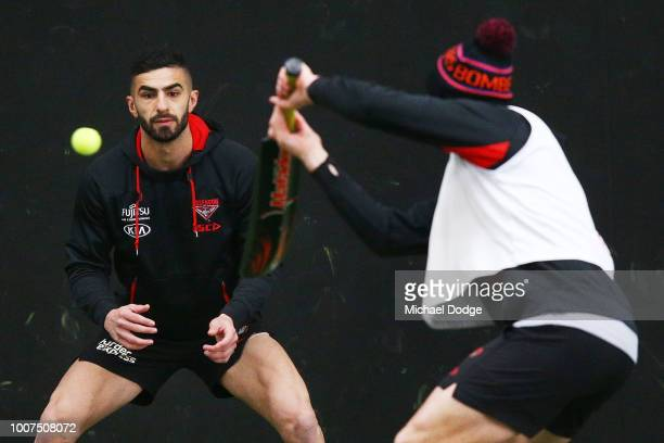 Adam Saad of the Bombers tries to catch a tennis ball when taking part in a reflex drill during an Essendon Bombers AFL training session at The...
