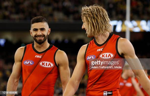 Adam Saad of the Bombers walks to the coin toss with captain Dyson Heppell of the Bombers during the 2018 AFL round 22 match between the Richmond...