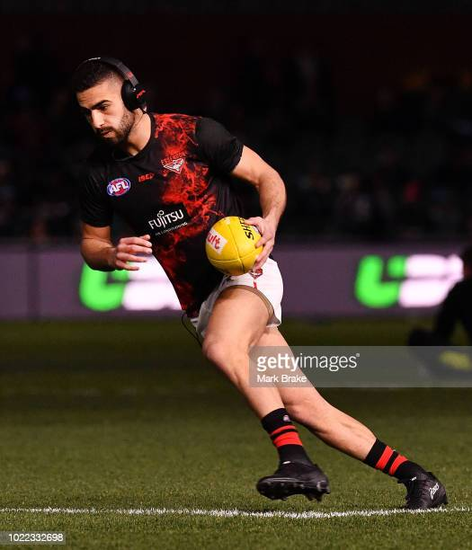 Adam Saad of the Bombers warms up before the round 23 AFL match between Port Adelaide Power and the Essendon Bombers at Adelaide Oval on August 24...