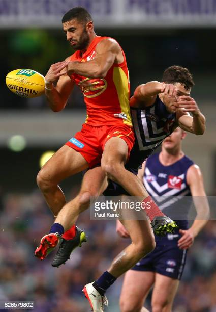 Adam Saad of the Suns and Hayden Ballantyne of the Dockers contest for a mark during the round 20 AFL match between the Fremantle Dockers and the...