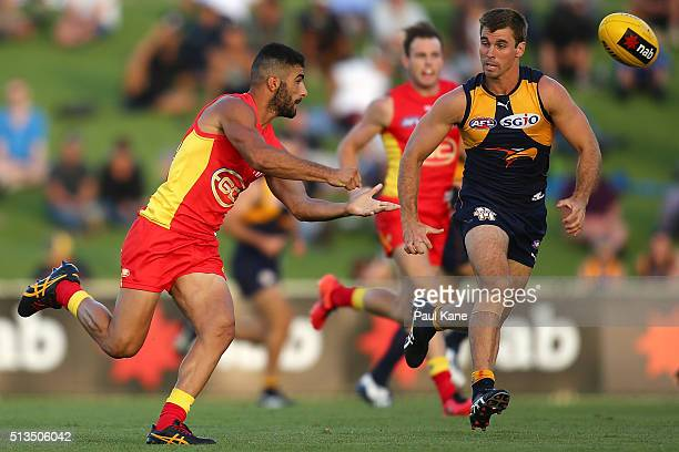 Adam Saad of the Suns handballs during the 2016 AFL NAB Challenge match between the West Coast Eagles and the Gold Coast Suns at HBF Arena on March 3...