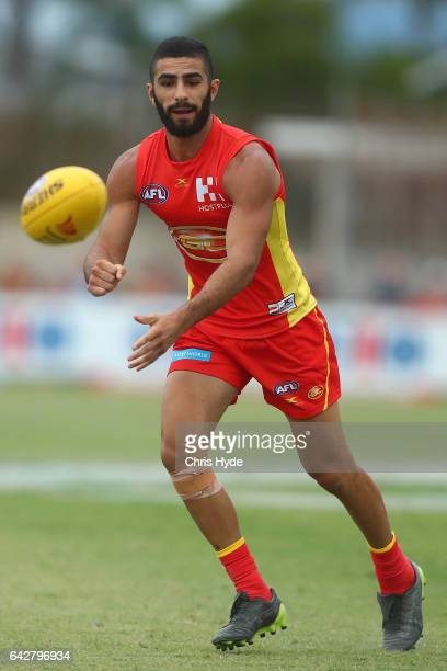 Adam Saad of the Suns handballs during the 2017 JLT Community Series match at Broadbeach Sports Centre on February 19 2017 in Gold Coast Australia