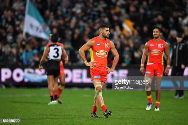 Adam Saad of the Suns looks on dejected after the round 23 AFL match between the Port Adelaide Power and the Gold Coast Suns at Adelaide Oval on...