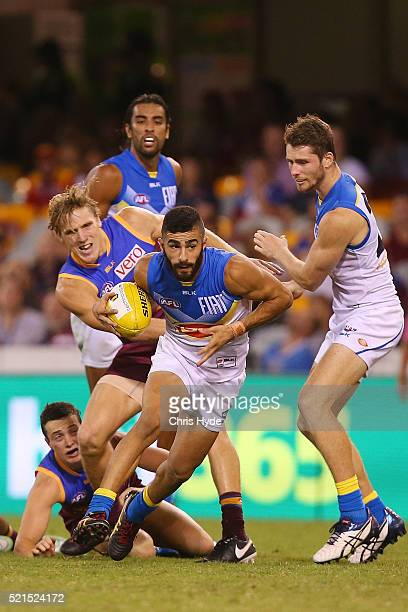 Adam Saad of the Suns runs the ball during the round four AFL match between the Brisbane Lions and the Gold Coast Suns at The Gabba on April 16 2016...